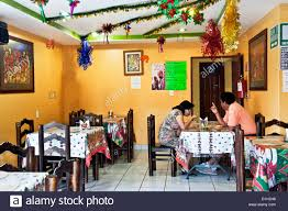 mexican couple eating comida in cheerful homestyle restaurant hung
