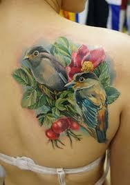 bird u0026 blue roses tattoo on thigh