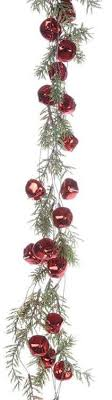 artificial pine garland with jingle bells and glitter and