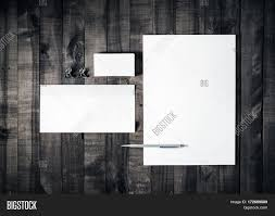 blank stationery set on wooden table background blank letterhead