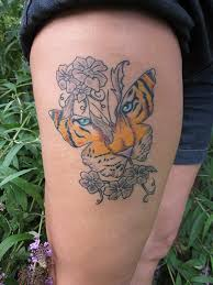 tiger in butterfly on thigh