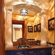 mexican style bathroom mediterranean with gold frame mirror dark