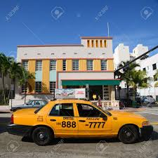 art deco style building viscay hotel and yellow cab on collins