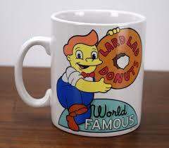 simpsons lard lad donuts coffee mug universal studios krustyland