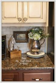 beige tan countertop cream cabinets and maybe this instead of a