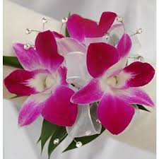 orchid corsage pink orchid corsage petal town flowers wine country weddings