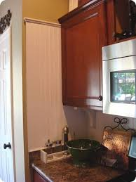 thrifty decor chick beadboard backsplash cozy kitchens i love the wainscoting used as a backsplash kitchen wainscoting
