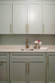 Laundry Room Cabinet Pulls Gray Laundry Room Cabinets With Brass Pulls Transitional