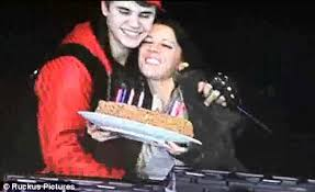 justin bieber saves his mother from a birthday cake fire after her
