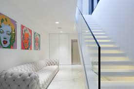 amazing glass staircase without handrails also modern white tufted