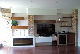 rectangle black fireplace plus floating light brown wooden shelves