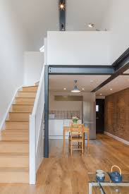 Small Home by Dilapidated Coach House Reinvented Into Small Home With Loft