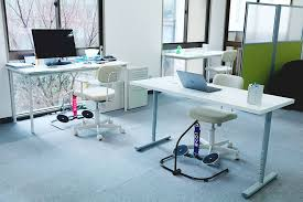 Exercise At The Office Desk 7 Benefits Of Using Desk Exercise Equipment Hovr
