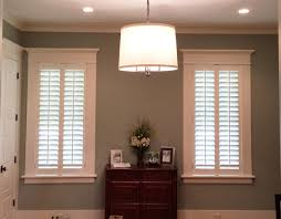 modern farmhouse with plantation shutters on the windows love the