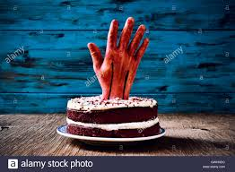 Halloween Red Velvet Cake by A Red Velvet Cake Topped With A Bloody Hand For Halloween On A