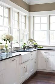 wall colors for white kitchen cabinets black countertops the many advantages of black kitchen countertops decorated