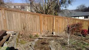 landscaping can i add a retaining wall to the base of the