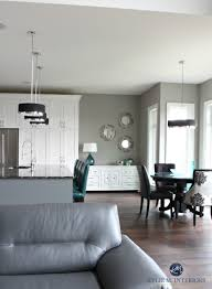 kitchen design consultant open layout kitchen and dining room white cabinets dark wood