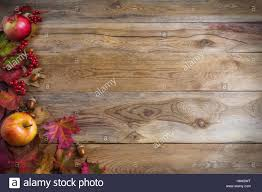 thanksgiving background with apples acorns berries and fall