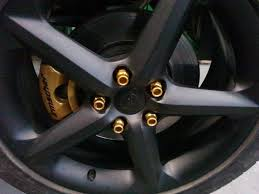 gold painted lug nuts and calipers