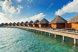 row of water villas in the maldives stock photo picture and