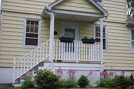 top notch cream wooden wall siding and white wooden front porch