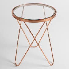 gold and glass table with a round glass top and a rose gold metal frame our