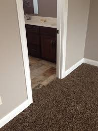 painting stained wood trim like carpet looks much darker in this pic and tile colors with