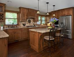 kitchen remodel designer in love with knotty alder cabinets dura supreme cabinetry