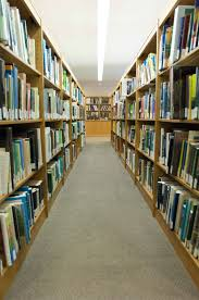 file bookshelves at the library jpg wikimedia commons