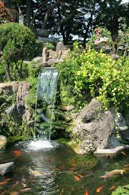 waterfall and koi pond in an asian garden wall mural u2022 pixers