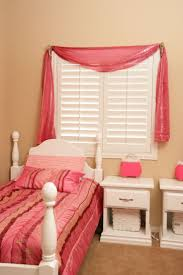 decorating charming sunburst shutters on cream wall with lovely