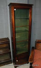 Narrow Mahogany Bookcase A 20th Century Narrow Mahogany Bookcase The Interior Green Baize