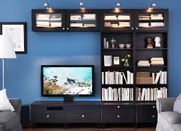 planning tools ikea a tv and books stored in an entertainment console with bookshelves to the right side against