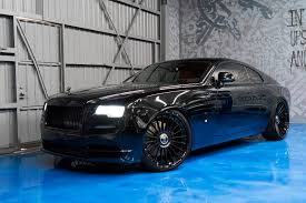 rolls royce wraith umbrella blacked out rolls royce wraith has orange interior forgiato