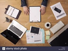businessman working at office desk holding a clipboard with a