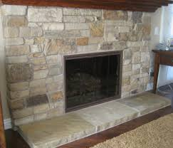 in vogue grey stone fireplace hearth ideas with black steel