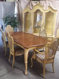 vintage french provincial dining table and cane in studio city