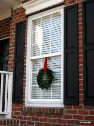 window wreaths christmas window wreaths windows classic with ribbon on and