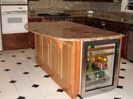 long brown wooden kitchen island with white counter top and sink