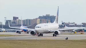 United Airline Stock Jet Blue Embraer 190 Passenger Jet Airliner Flying Over Gravelly