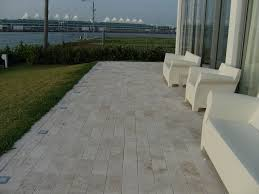 miami ivory travertine tile patio modern with kartell beach style