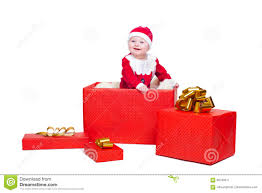 baby boy standing in a huge christmas gift box stock photo image