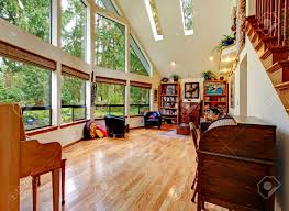 vaulted ceiling living room big living room with high vaulted ceiling glass wall and hardwood