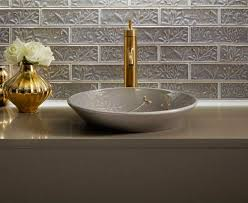 contemporary bathroom with grey glossy kohler vessel sink and