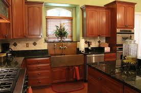 copper colored appliances copper sink copper accented backsplash dark countertops