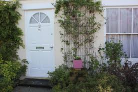 front garden design featuring metal wall trellis that are great