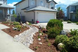 dry creek bed in your landscaping design makes this front yard