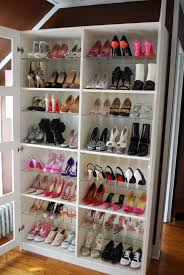 bedroom shoe closet organizer with white wooden ladder shelves as