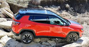 red jeep compass we have a 2017 jeep compass trailhawk for a week send us your
